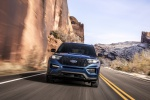 Picture of a driving 2020 Ford Explorer ST EcoBoost 4WD in Atlas Blue Metallic from a frontal perspective