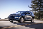Picture of a driving 2020 Ford Explorer Limited in Atlas Blue Metallic from a front left perspective