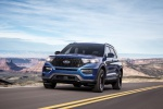 Picture of a driving 2020 Ford Explorer ST EcoBoost 4WD in Atlas Blue Metallic from a front left perspective