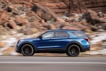 Picture of a driving 2020 Ford Explorer ST EcoBoost 4WD in Atlas Blue Metallic from a left side perspective