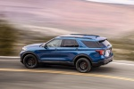Picture of a driving 2020 Ford Explorer ST EcoBoost 4WD in Atlas Blue Metallic from a rear left three-quarter perspective