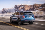 Picture of a driving 2020 Ford Explorer ST EcoBoost 4WD in Atlas Blue Metallic from a rear left perspective