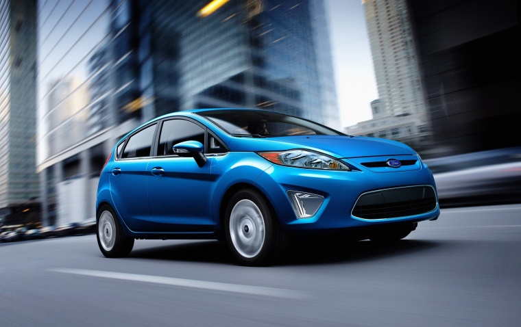 Driving 2012 Ford Fiesta Hatchback in Blue Flame Metallic from a front right three-quarter view