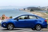 2012 Ford Fiesta Sedan in Blue Flame Metallic from a side view