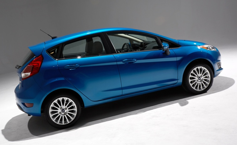 2015 Ford Fiesta Hatchback Titanium in Blue Candy Metallic Tinted Clearcoat from a rear right three-quarter view