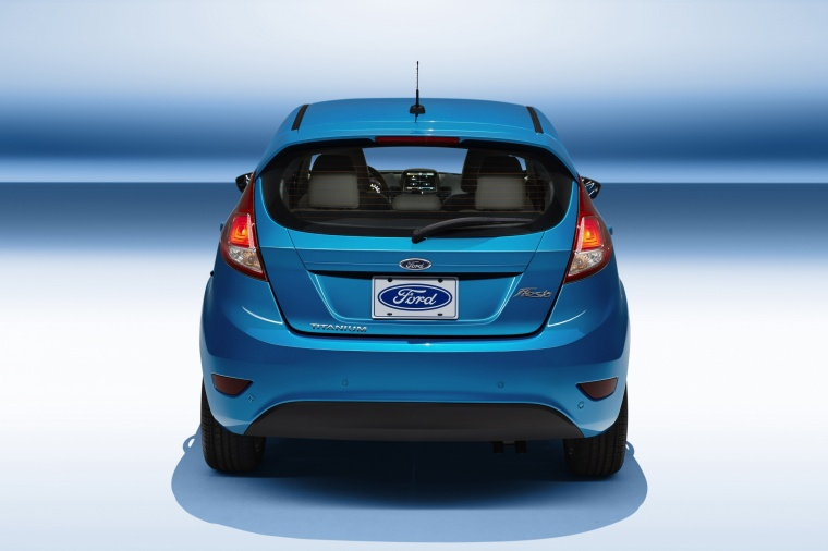 2015 Ford Fiesta Hatchback Titanium in Blue Candy Metallic Tinted Clearcoat from a rear view