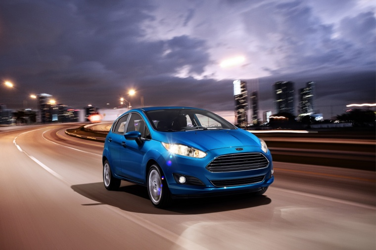 Driving 2015 Ford Fiesta Hatchback Titanium in Blue Candy Metallic Tinted Clearcoat from a front right view