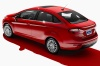2015 Ford Fiesta Sedan Titanium in Race Red from a rear left three-quarter view