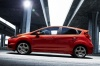 2015 Ford Fiesta Hatchback ST in Race Red from a side view