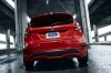 Driving 2015 Ford Fiesta Hatchback ST in Race Red from a rear view