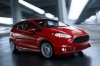 Driving 2015 Ford Fiesta Hatchback ST in Race Red from a front right three-quarter view