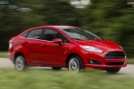 2015 Ford Fiesta Sedan Titanium in Ruby Red Metallic Tinted Clearcoat - Driving Front Right Three-quarter View