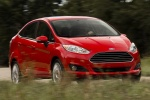2015 Ford Fiesta Sedan Titanium in Ruby Red Metallic Tinted Clearcoat - Driving Front Right View