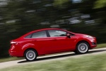 2018 Ford Fiesta Sedan Titanium in Red - Driving Rear Right Three-quarter View