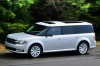 Driving 2018 Ford Flex SEL in Ingot Silver Metallic from a left side view