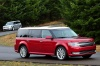 Driving 2018 Ford Flex SEL in Ruby Red Metallic Tinted Clearcoat from a front right three-quarter view