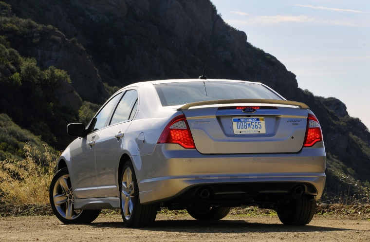 2012 Ford Fusion Sport AWD in Brilliant Silver Metallic from a rear left view