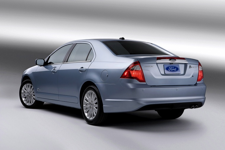 2012 Ford Fusion Hybrid in Light Ice Blue Metallic from a rear left view