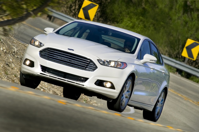 Driving 2016 Ford Fusion Titanium AWD in Oxford White from a front left view