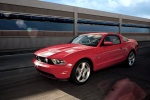 2011 Ford Mustang GT Coupe in Race Red - Driving Front Left Three-quarter View