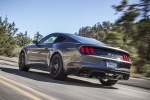 2017 Ford Mustang GT Fastback in Guard Metallic - Driving Rear Left Three-quarter View