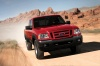 Driving 2010 Ford Ranger in Torch Red from a frontal view