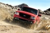 Driving 2010 Ford Ranger in Torch Red from a front left view
