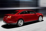 2011 Ford Taurus SHO in Candy Red Metallic Tinted Clearcoat - Driving Rear Right Three-quarter View