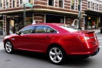 2011 Ford Taurus SHO in Candy Red Metallic Tinted Clearcoat - Static Rear Left Three-quarter View