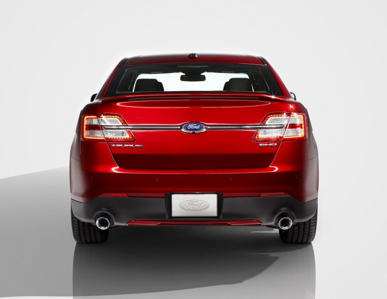 2014 Ford Taurus SHO Sedan in Ruby Red Metallic Tinted Clearcoat from a rear view