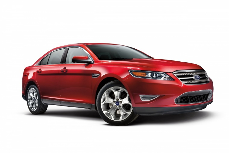 2014 Ford Taurus SHO Sedan in Ruby Red Metallic Tinted Clearcoat from a front right three-quarter view
