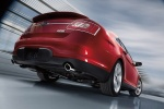 2018 Ford Taurus SHO Sedan in Ruby Red Metallic Tinted Clearcoat - Driving Rear Right View
