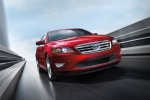 2018 Ford Taurus SHO Sedan in Ruby Red Metallic Tinted Clearcoat - Driving Front Right View