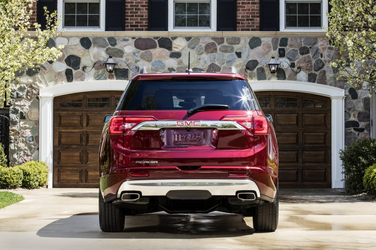 2017 GMC Acadia Denali in Crimson Red Tintcoat from a rear view