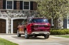 2017 GMC Acadia Denali in Crimson Red Tintcoat from a rear left view