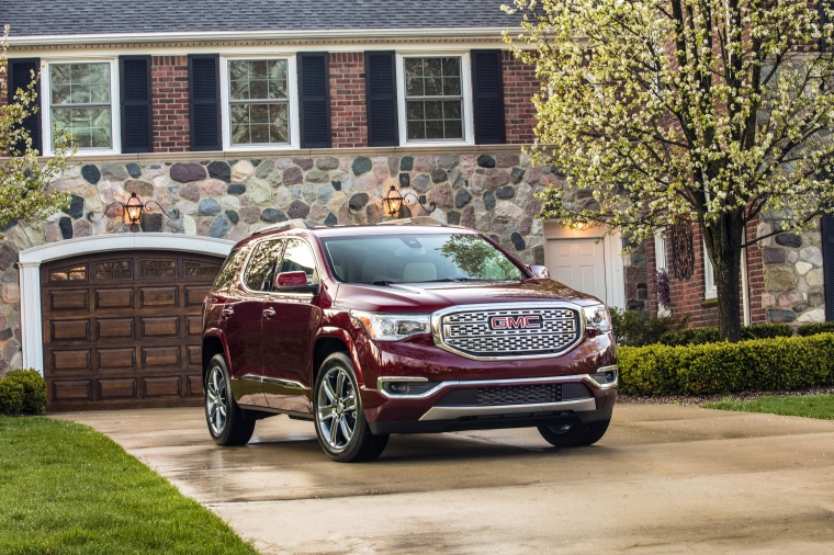 2018 GMC Acadia Denali in Crimson Red Tintcoat from a front right view