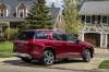 2018 GMC Acadia Denali in Crimson Red Tintcoat from a rear right three-quarter view
