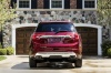 2018 GMC Acadia Denali in Crimson Red Tintcoat from a rear view