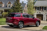 Picture of a 2019 GMC Acadia Denali in Red from a rear right three-quarter perspective