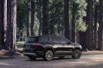 Picture of a 2019 GMC Acadia All Terrain in Ebony Twilight Metallic from a rear right three-quarter perspective