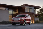 Picture of a 2019 GMC Acadia Denali in Red from a front left perspective