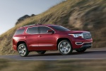 Picture of a driving 2019 GMC Acadia Denali in Red from a front right three-quarter perspective