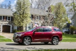 Picture of a driving 2019 GMC Acadia Denali in Red from a side perspective