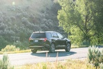 2020 GMC Acadia Denali AWD in Carbon Black Metallic - Driving Rear Right View
