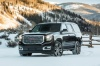 2018 GMC Yukon Denali in Onyx Black from a front left three-quarter view