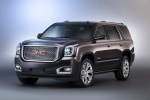 Picture of a 2018 GMC Yukon Denali from a front left three-quarter perspective