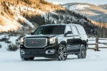 Picture of a 2018 GMC Yukon Denali in Onyx Black from a front left three-quarter perspective