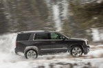 Picture of a driving 2018 GMC Yukon Denali in Onyx Black from a right side perspective