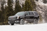 Picture of a driving 2018 GMC Yukon Denali in Onyx Black from a front left three-quarter perspective