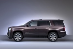 Picture of a 2018 GMC Yukon Denali from a side perspective